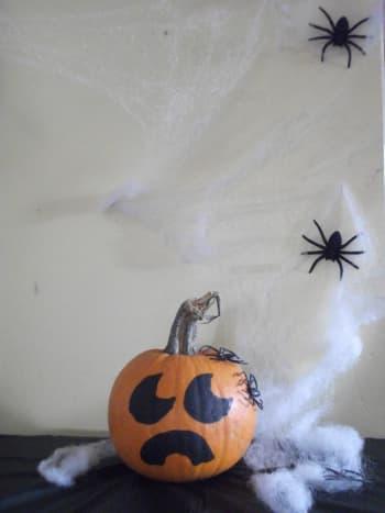Put your pumpkin under spider web and put spiders around it like it is under attack.