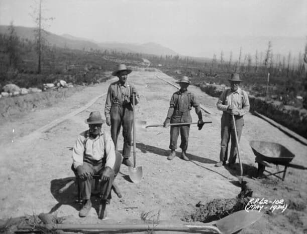 Men in British Columbia, CA working on a highway and living in a labor camp. They were not paid.