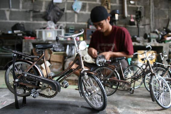Craftsman makes famous antique bicycle miniature in his simple workshop in villages around Yogyakarta City, Central Java Province, Indonesia