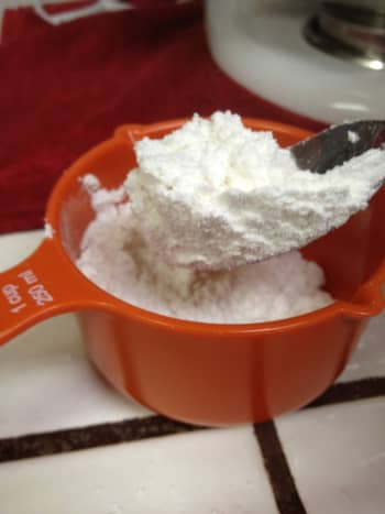 Measure out the flour with a spoon. DO NOT just put the measuring spoon inside the bag and scoop the flour. you will end up with too much flour!
