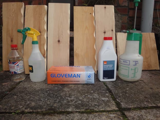 Materials and equipment to prepare wood for wood staining, diluted caustic soda and diluted white vinegar