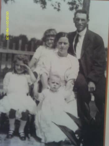 Ava as a toddler with siblings, mother and father