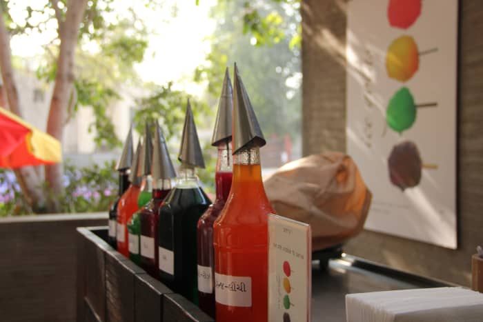 The array of colored syrups at the golawala's cart