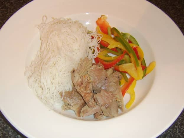 Turkey leg meat, rice noodles and sliced bell peppers