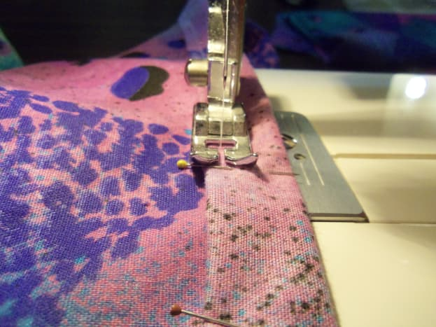 Sew as closely to the seam as possible, keeping the fold as your guide.