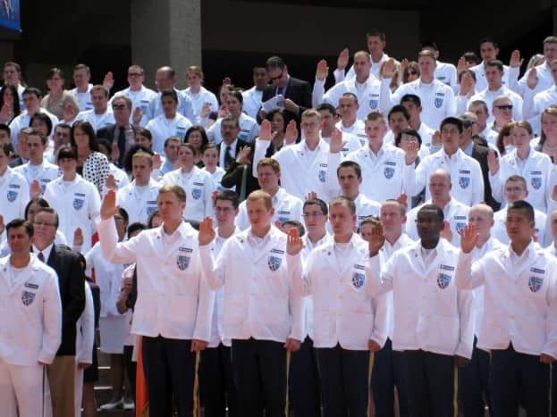 """USUHS White Coat Ceremony. Medical students receive their white coats and take the Hippocratic Oath: """"First, do no harm..."""""""