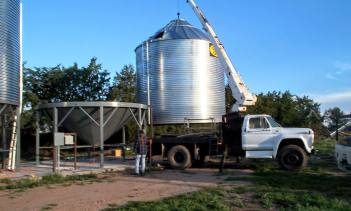 On this job with another 18-foot diameter, 4,000 bushel bin, we had a crew of four people including the boom truck operator and cameraman.