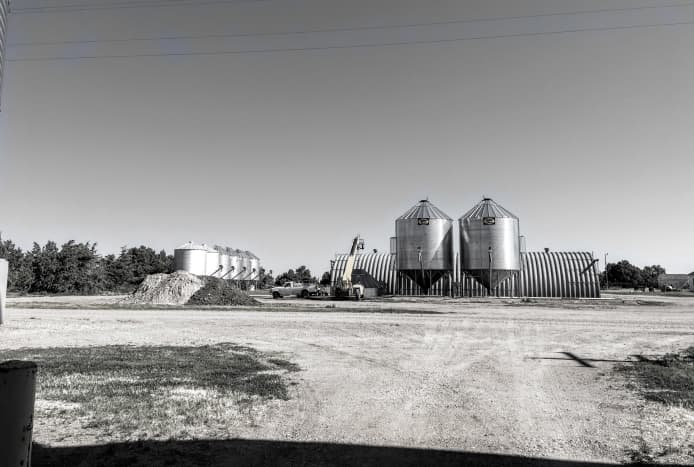 This jobsite is known as the Grain Bin Corner, as it includes 10 bins such as the two featured in this article, plus others on both sides of the gravel road. Almost all eras of bins are represented from the mid-1940's on.