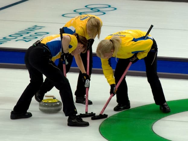 Sweeping is done 1) to reduce friction underneath the stone, and 2) to decrease the amount of curl.