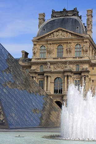 Ancient and modern. Juxtaposition of architecture at the Louvre. The building in the background is the Pavillon Richelieu, part of the north wing of the museum