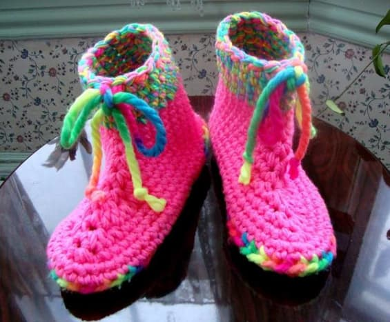 These slippers are worked with a super thick neon sole material and multiple strands on toppers.