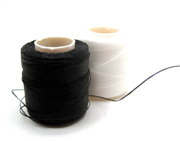 I always keep large spools of both white and black thread in my toolbox.