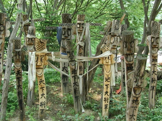 Carved Korean poles appear in this photo set. Korean Jangseung poles in historical folk village  at Yongin in Gyeonggi-do.