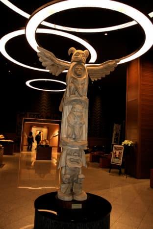 Ainu pole in Tsuruga Wings Ryokan in Akan, Japan. Ainu poles often include three-dimensional carvings.