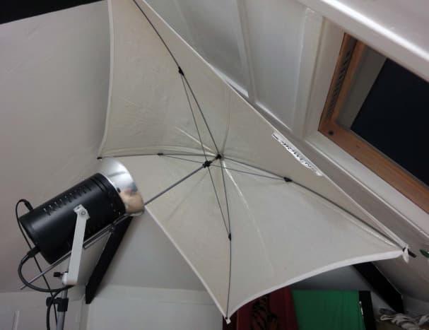 Studio light and umbrella in loft conversion photographic studio