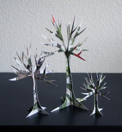 http://alittlehut.blogspot.com/2007/08/recycled-project-no-6-junk-mail-trees.html - link no longer active