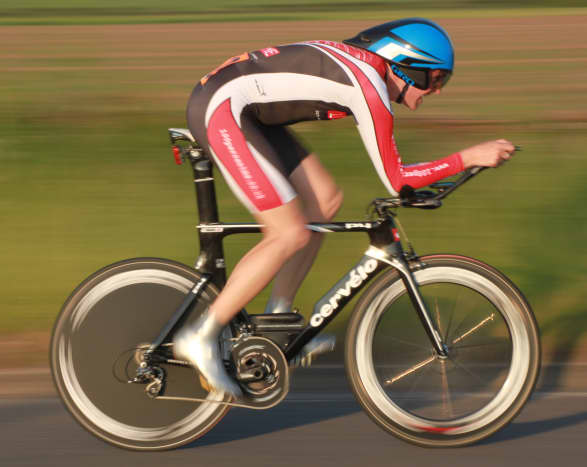A Cervelo P4 with Zipp Disc and 808 front wheel in a panning photography shot
