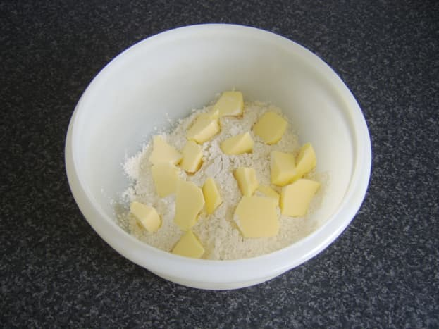 Butter is cut in to flour in a mixing bowl