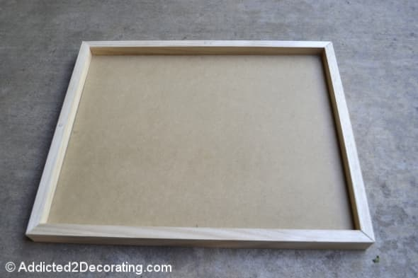 Step 1. Measure and cut frame pieces to fit around the outside of each MDF piece.  Dry fit the frame pieces.  If gaps between the frame and MDF are evident, measure and cut smaller trim to fit inside the frame pieces, atop the MDF itself.  Once all f