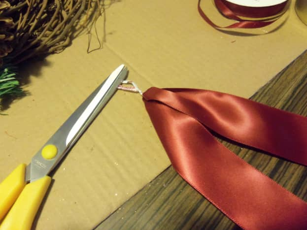 Cut the satin ribbon and fold it in half to make a tail.  Use wire or twist tie to hold the center evenly.