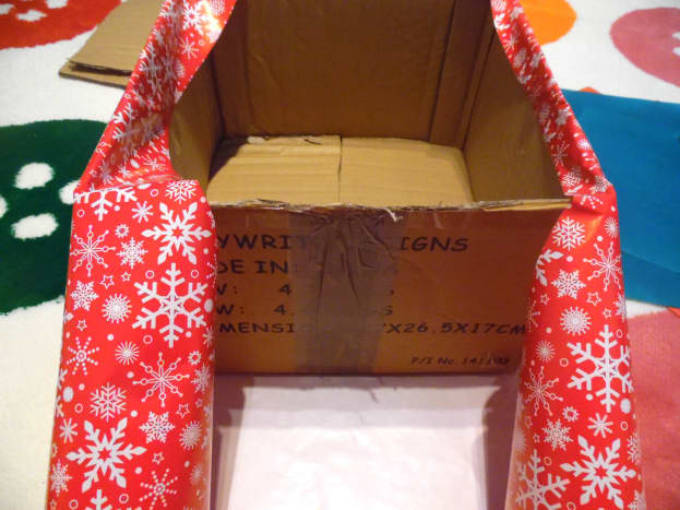 Secure the wrap to the inside of the box with some tape