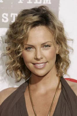 medium length curly hairstyle 2015 with layers for girls