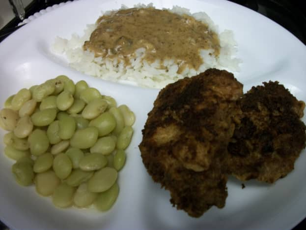 Fried cubed steak, baby lima beans, and rice with milk gravy.