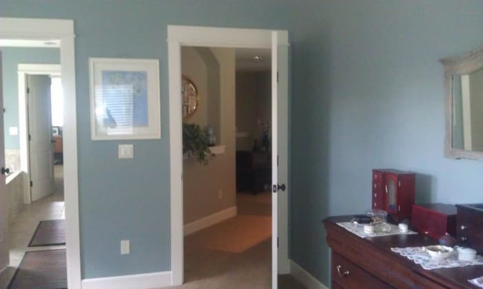 Soothing blue interior paint in the bedroom and bathroom