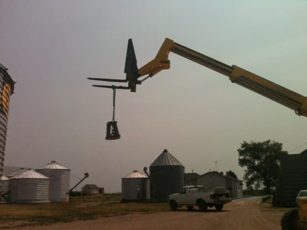 The lifting ring hangs out of the way while the rest of the job site is set up for the day's building.