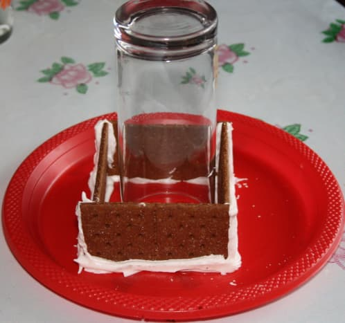 Paste the 4 walls on the plastic plate. Put a glass in the middle to support the walls.