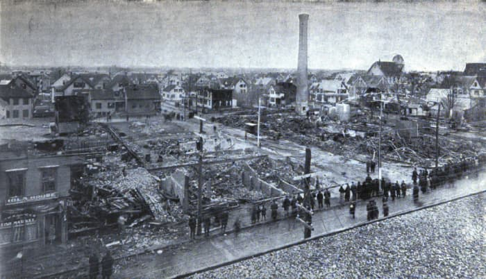 View of the Grover Shoe factory boiler explosion disaster from Church & Alden Shoe Factory, Brockton, Massachusetts. March 20, 1905. Smokestack and ruins at right, Dahlborg Block at left, ruined dwellings in background.