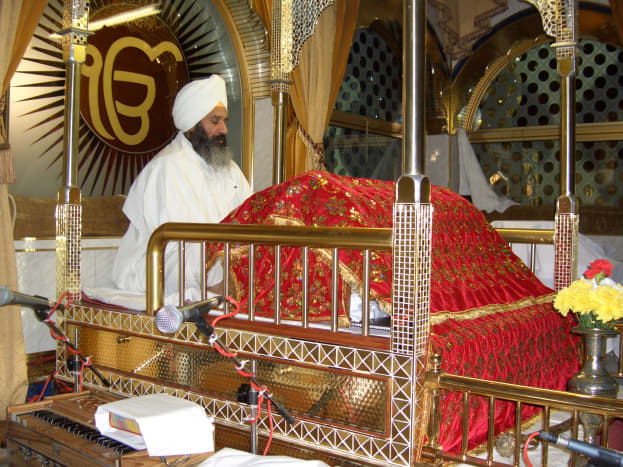 The Guru Granth Sahib, the Holy book of the Sikhs is kept on a manji (throne), on a raised platform in the center of the room. It is covered with a cloth called Rumala Sahib at all times as a mark of respect.