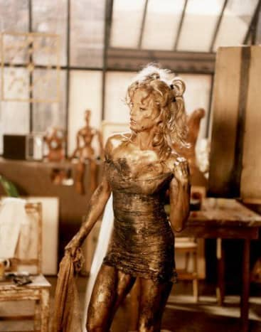 Farrah Fawcett greased up in a gold dress
