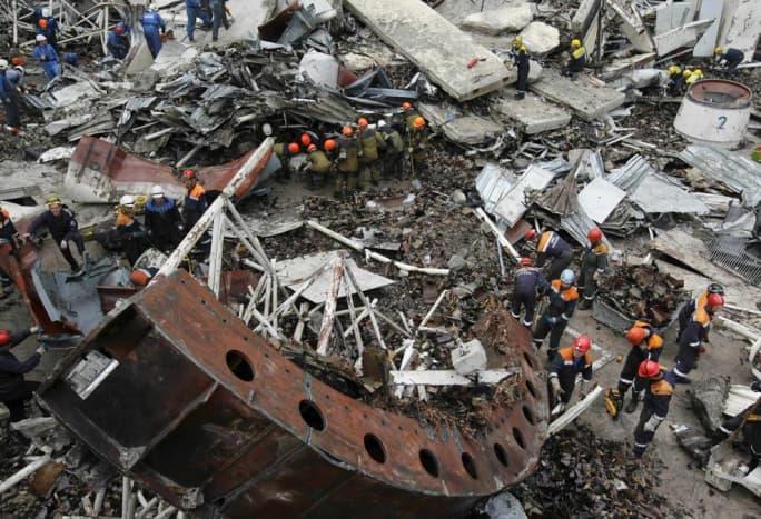 Rescuers working at the damaged Sayano-Shushenskaya dam.     (AP Photo)