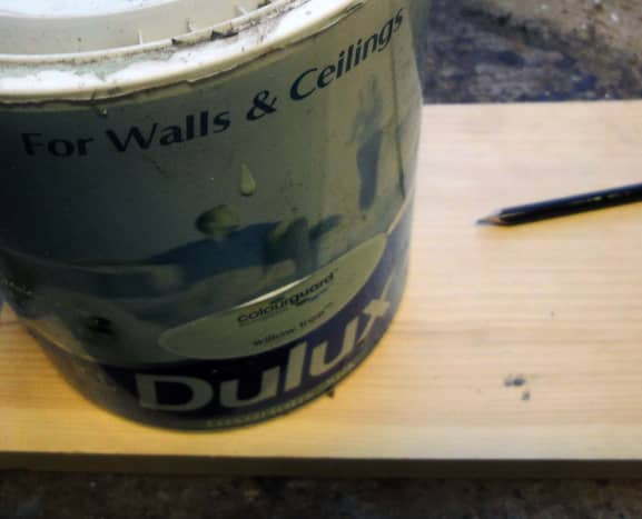 Mark wood to cut using paint tin as template