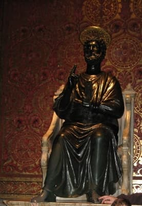 Bronze statue of Saint Peter. His left foot is worn from all pilgrims touching it in sign of worship and prayer.