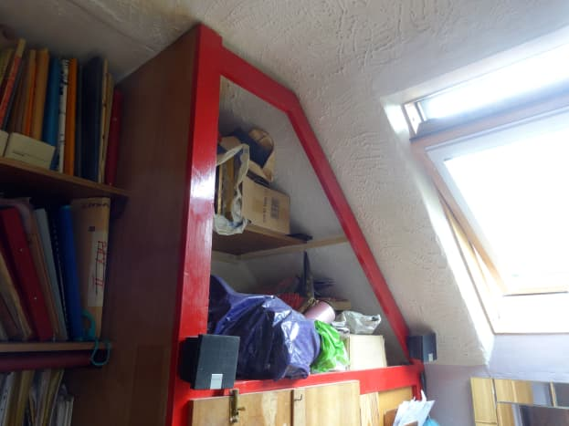 Original open cupboard above built-in wardrobe.  The following photos are the highlights of the modifications made, including the folding doors