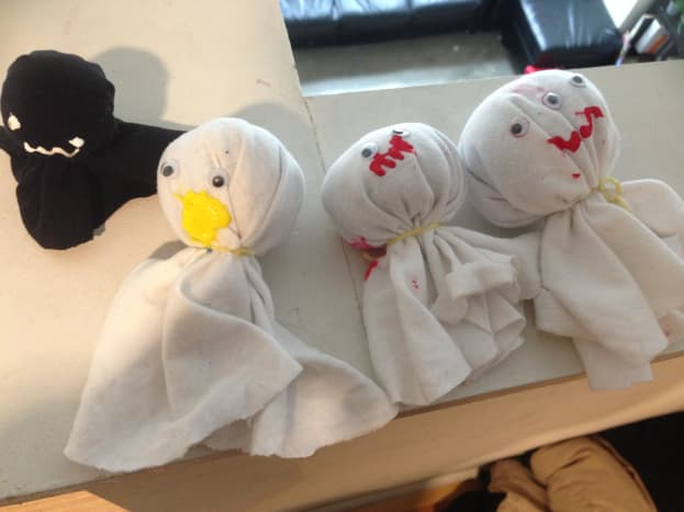 Little ghosts made with scrap fabric, stuffing, puff paint, and googly eyes.