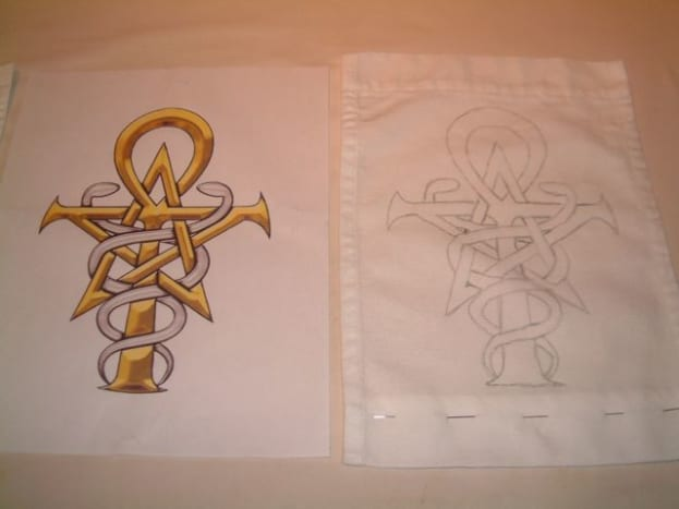 To start, I traced my design onto a pre-sewn cotton banner.