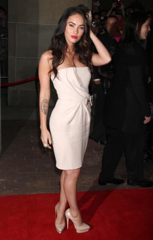 Megan Fox in a white dress and high heels