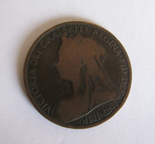 """This coin is 1¼"""" in diameter."""