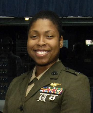 US Marine Corps officer Vernice Armour in 2006 - 1st female African-American naval aviator/combat pilot in the United States military. Shown with short, smoothed hair.
