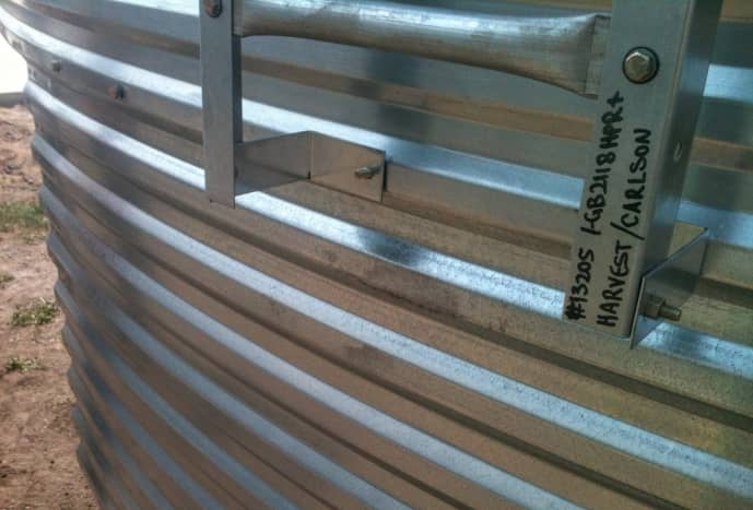Manufacturer's specifications are written with a permanent marker on this ladder section.