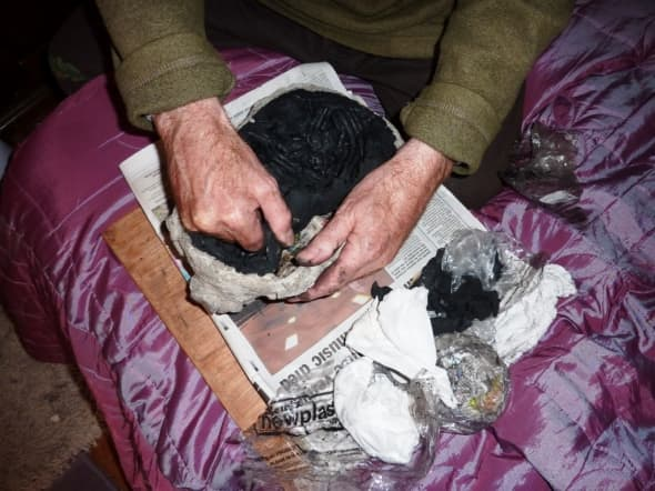 Here the plasticine is removed from the dried mask.