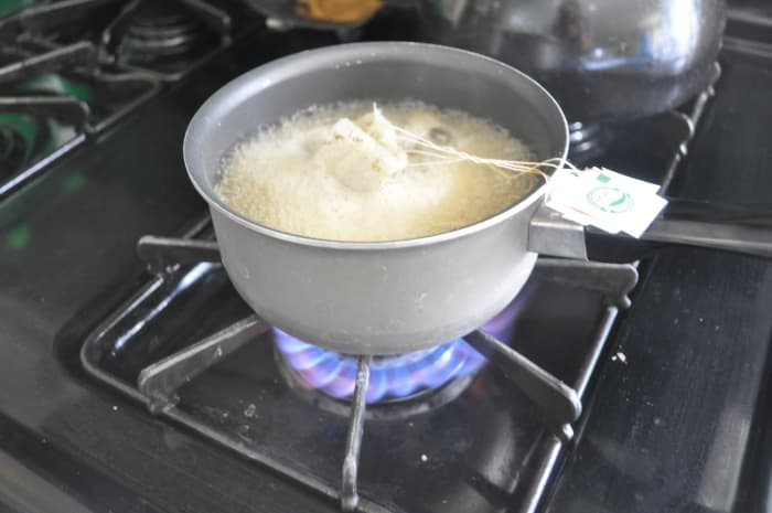 Boil the water and tea bags. Be careful so the paper on the tea bags don't catch on fire.
