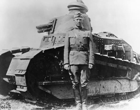 Patton led the evolution of the tank in the American Army, he's standing near his tank in the First World War. The American Army use French tanks in the First World War due to the fact the United States didn't have a tank in its arsenal.
