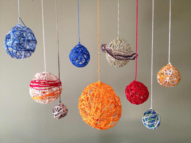 Our completed yarn ball solar system project.