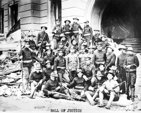 Soldiers outside Hall of Justice in San Francisco 1906. US Army soldiers from the Presidio pose for a group shot, with their Springfield 03 rifles, in front of the ruins of the Hall of Justice. The troops aided the local police force in keeping order