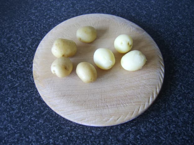 Peeling the boiled and cooled potatoes