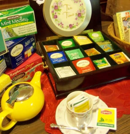 Cherry tea chest has a selection of teas, not including the loose tea always on hand. The tea cup and saucer are from two departed dear friends.